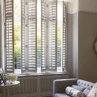 Full Height Vinyl Shutters by Luxaflex supplied by Harmony