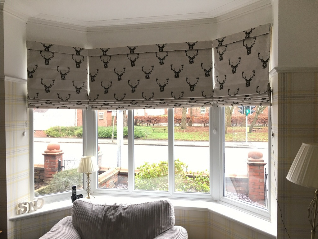 Roman blinds harmony blinds of bristol for Roman shades for bay window