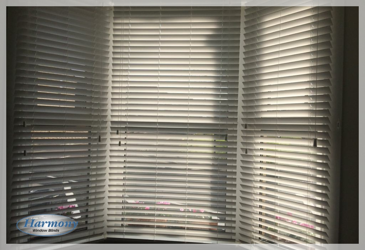 Cream Wooden Blinds in a Bay Window