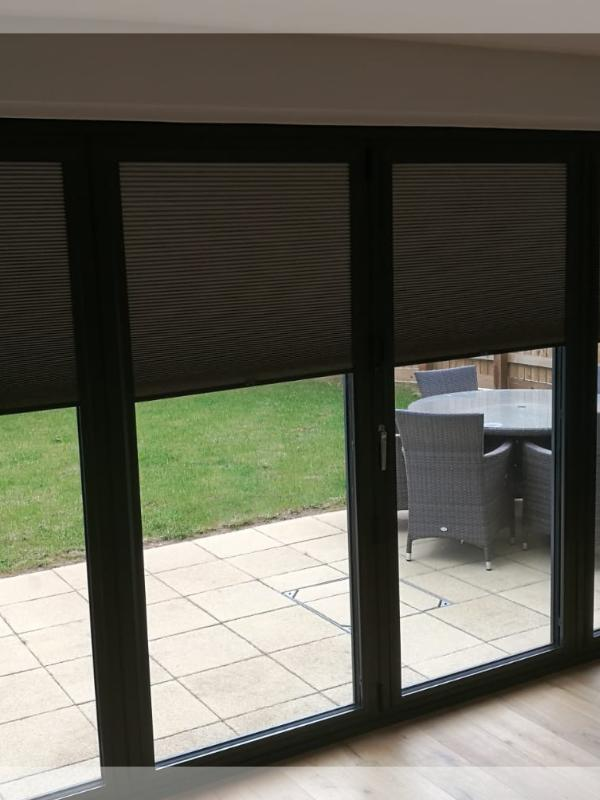 Anthracite Grey Bi-fold Doors with Grey Perfect Fit Blinds