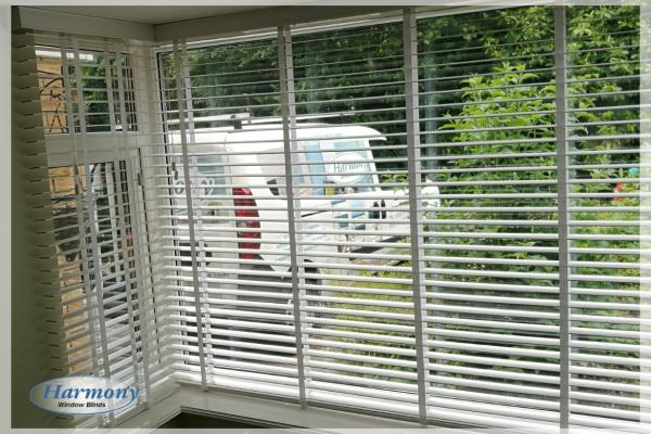 Real Wood Venetian Blinds with Ladder Tapes in a Bay Window